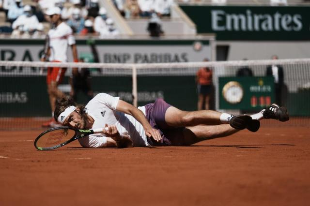 Stefanos Tsitsipas of Greece falls on the clay as he plays Serbia's Novak Djokovic during their final match of the French Open tennis tournament at the Roland Garros stadium Sunday, June 13, 2021 in Paris. (AP Photo/Thibault Camus)