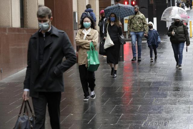 People filter into the city after more than 100 days of lockdown to help contain the COVID-19 outbreak in Sydney, Monday, Oct. 11, 2021. (AP Photo/Rick Rycroft)