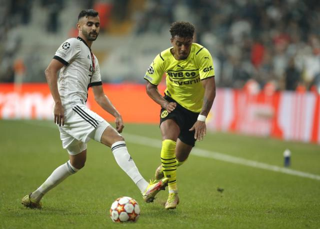 Besiktas' Rachid Ghezzal, left, challenges for the ball with Dortmund's Donyell Malen during the Champions League Group C soccer match between Besiktas and Borussia Dortmund at the Vodafone Park Stadium in Istanbul, Turkey, Wednesday, Sept. 15, 2021. (AP Photo)
