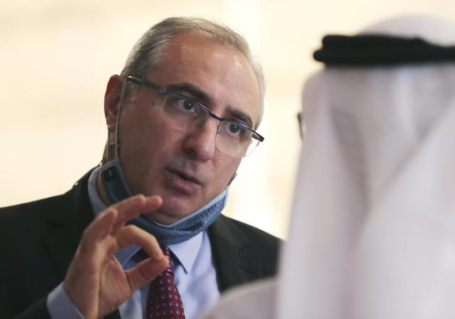 Israel's ambassador to the UAE, Eitan Na'eh talks with an Emirati official during the Global Investment Forum in Dubai, United Arab Emirates, Wednesday, June 2, 2021. At the luxurious Armani hotel inside the world's tallest skyscraper in Dubai, Israelis in kippas and Emiratis in long white robes and kanduras gathered Wednesday to discuss investment opportunities aimed at making the most of deepening ties nine months after the two countries agreed to formalize relations. (AP Photo/Kamran Jebreili)