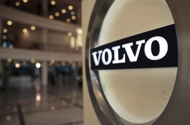 FILE - This Feb. 6, 2020, file photo shows the Volvo logo in the lobby of the Volvo corporate headquarters in Brussels. A tentative labor deal between Volvo Trucks North America and a union representing nearly 3,000 workers who have gone on strike twice in 2021 at a southwest Virginia truck plant was rejected by the striking workers, late Friday, July 9, 2021. (AP Photo/Virginia Mayo, File)