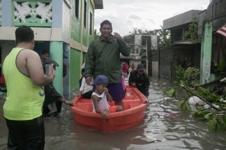 Mass evacuation complicated and slowed by the coronavirus  has Philippine residents riding out the typhoon