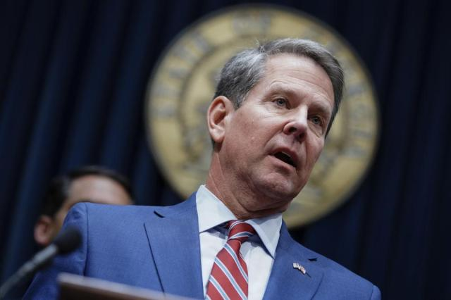FILE - In this Dec. 4, 2019, file photo, Georgia Gov. Brian Kemp takes questions from the media at the Georgia state Capitol in Atlanta. Supporters of Republican Georgia Gov. Brian Kemp are fighting back against Donald Trump and their own party leaders. They are angered by Trump's Sept. 25 rally in Georgia where the former president again attacked Kemp.  (AP Photo/Elijah Nouvelage, File)