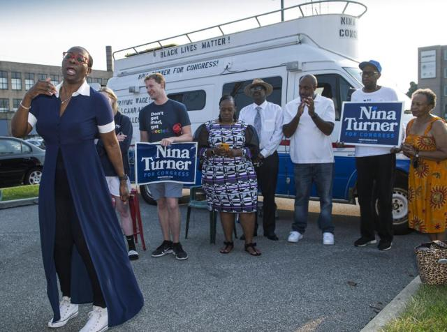 In this July 7, 2021, photo Nina Turner, a candidate running in a special Democratic primary election for Ohio's 11th Congressional District speaks with supporters near the Cuyahoga County Board of Elections before casting her vote in Cleveland. (AP Photo/Phil Long)