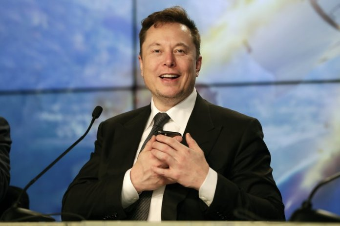FILE - In this Sunday, Jan. 19, 2020. file photo, Elon Musk founder, CEO, and chief engineer/designer of SpaceX speaks during a news conference after a Falcon 9 SpaceX rocket test flight to demonstrate the capsule's emergency escape system at the Kennedy Space Center in Cape Canaveral, Fla. Elon Musk is not content with just electric cars, populating Mars, and building underground tunnels to solve traffic problems. He also wants to get inside your brain. His startup, Neuralink, wants to one-day implant computer chips inside people's brains. (AP Photo/John Raoux, File)