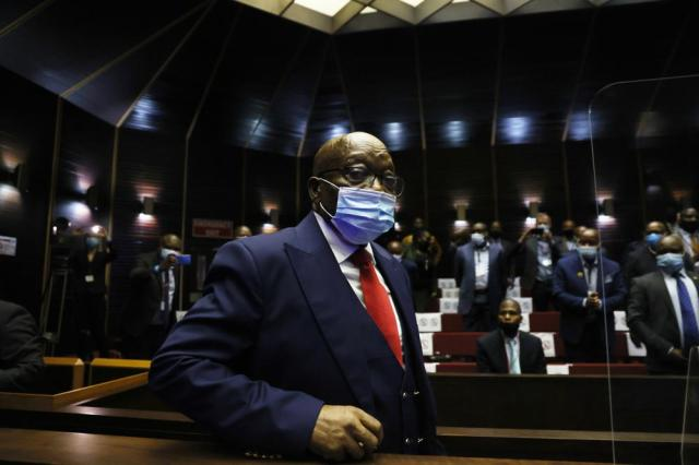 Former South African President Jacob Zuma, arrives at the High Court in Pietermaritzburg, South Africa, Wednesday May 26, 2021. Zuma faces corruption charges alongside French arms company Thales dating back to 1999. (AP Photo/Phill Magakoe/Pool)