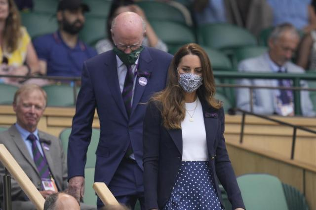 Britain's Kate, Duchess of Cambridge arrives in the Royal Box on Centre Court on day five of the Wimbledon Tennis Championships in London, Friday July 2, 2021. (AP Photo/Kirsty Wigglesworth)