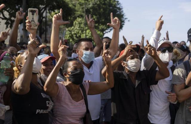 Anti-government protesters march in Havana, Cuba, Sunday, July 11, 2021. As Cubans facing the country's worst economic crisis in decades took to the streets in droves over the weekend into Monday, July 12, 2021, authorities blocked social media sites in an apparent effort to stop the flow of information into, out of and within the beleaguered nation. (AP Photo/Eliana Aponte, file)
