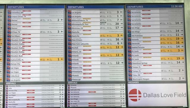 A flight information board shows cancellations for a number of Southwest Airlines flights, Sunday, Oct. 10, 2021, at Dallas Love Field. Southwest Airlines canceled hundreds of flights over the weekend, blaming the woes on air traffic control issues and weather. (AP Photo/Julie March)