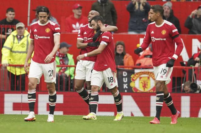 Manchester United's Anthony Martial, 3rd from right, celebrates with teammates after scoring his side's opening goal during the English Premier League soccer match between Manchester United and Everton, at Old Trafford, Manchester, England, Saturday, Oct. 2, 2021. (Dave Thompson, Pool via AP)