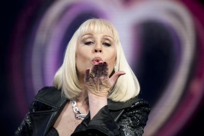 Raffaella Carra' blows a kiss in this May 14, 2011 photo. Italian Rai state TV says Raffaella Carra', for decades one of Rai's most popular entertainers, has died. It quoted the star's family as saying she died on Monday, July 5, 2021 after a long illness but in keeping with her wishes no details were being released. Carra', 78, with her energetic prancing on stage and forceful singing voice, was a beloved, longtime staple in the early heyday decades of the state broadcaster. (Virginia Farneti/LaPresse via AP)