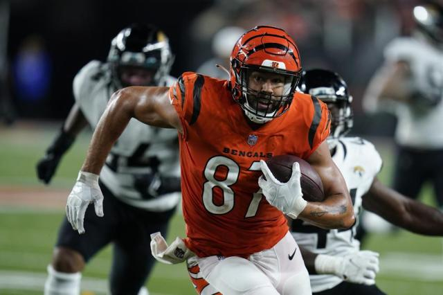 Cincinnati Bengals' C.J. Uzomah (87) goes in for a touchdown during the second half of an NFL football game against the Jacksonville Jaguars, Thursday, Sept. 30, 2021, in Cincinnati. (AP Photo/Michael Conroy)