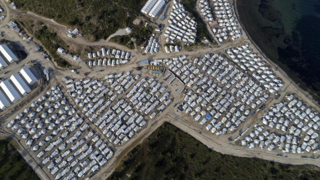 FILE - In this March 29, 2021 file photo, tents are seen from above at Karatepe refugee camp, on the eastern Aegean island of Lesbos, Greece. Since well over 1 million migrants entered the EU in 2015, most of them refugees fleeing conflict in Syria, the world's biggest trading bloc has spent vast sums of money to help ensure that migrants no longer set out for Europe whether by arduous overland treks or dangerous sea journeys. (AP Photo/Panagiotis Balaskas, File)