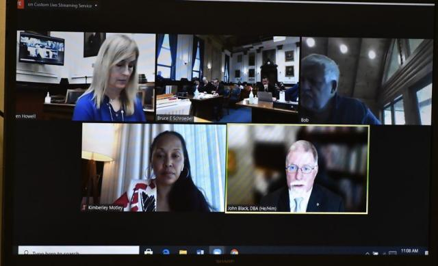 Expert witness John Black, bottom right, appears via video during a motion hearing, Tuesday, Oct. 5, 2021, in Kenosha, Wis., for Kyle Rittenhouse, who is accused of shooting three people during a protest against police brutality in Wisconsin last year.  (Sean Krajacic/The Kenosha News via AP, Pool)