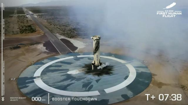 This photo provided by Blue Origin, Blue Origin's New Shepard rocket lands near Van Horn, Texas, Tuesday, July 20, 2021.  Jeff Bezos has blasted into space on his rocket company's first flight with passengers. He's the second billionaire in just over a week to ride his own spacecraft. The Amazon founder soared to space with a hand-picked group in his Blue Origin capsule and landed 10 minutes later on the desert floor.  (Blue Origin via AP)