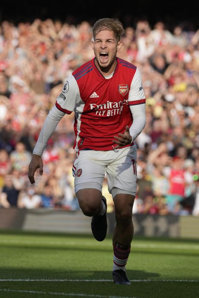 Arsenal's Emile Smith Rowe celebrates after scoring his side's opening goal during the English Premier League soccer match between Arsenal and Tottenham Hotspur at the Emirates stadium in London, Sunday, Sept. 26, 2021. (AP Photo/Frank Augstein)