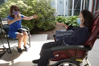 Many connect for the first time in months as visits resume in nursing homes across Massachusetts