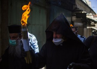 Eastern Christians mark Easter, the day Christians believe Jesus was resurrected after his crucifixion, a week after the Catholic calendar in an empty Church of the Holy Sepulcher in Jerusalem