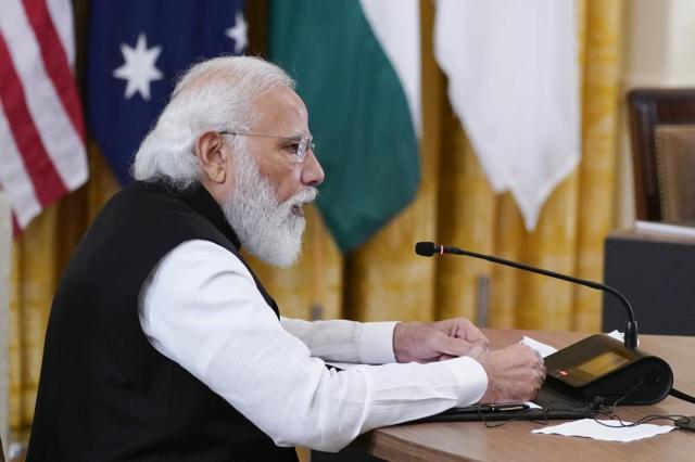Indian Prime Minister Narendra Modi speaks during the Quad summit with President Joe Biden, Australian Prime Minister Scott Morrison and Japanese Prime Minister Yoshihide Suga in the East Room of the White House, Friday, Sept. 24, 2021, in Washington. (AP Photo/Evan Vucci)