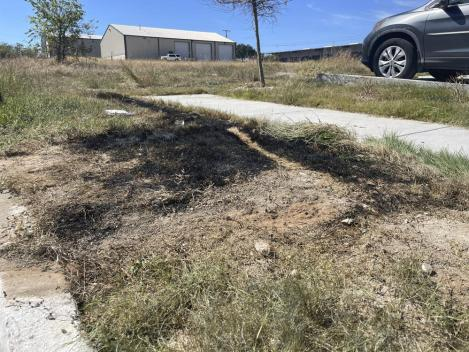 This Sept. 24, 2021 photo provided by Jason Allen and KTVT, shows the spot in Fort Worth, Texas, where a dumpster was on fire that had dismembered bodies inside. Police said the bodies appeared to be those of a man, a teen girl or adult woman, and a child. As of Monday, Sept. 27, 2021, authorities had identified only the man. Police have said the identification process has been difficult because of the condition of the bodies. (Jason Allen/KTVT via AP)
