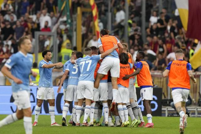 Lazio players celebrate after scoring their second goal during a Serie A soccer match between Lazio and Roma, at Rome's Olympic Stadium, Sunday, Sept. 26, 2021. (AP Photo/Andrew Medichini)
