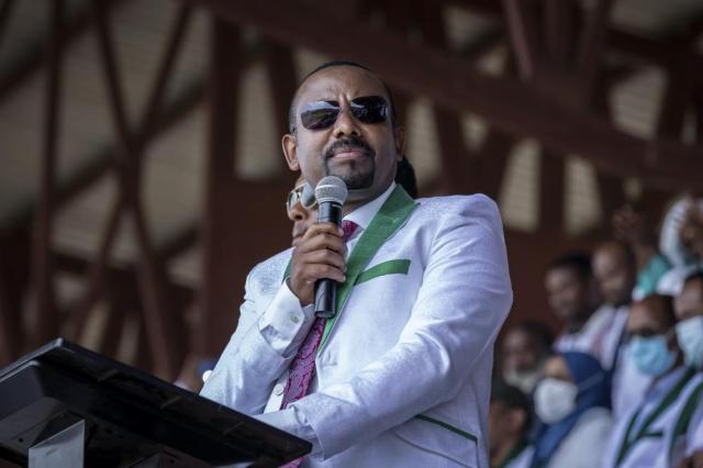 FILE - In this Wednesday, June 16, 2021 file photo, Ethiopia's Prime Minister Abiy Ahmed speaks at a final campaign rally at a stadium in the town of Jimma in the southwestern Oromia Region of Ethiopia. Ethiopia's ruling Prosperity Party was declared on Saturday, July 10, 2021 the winner of last month's national election in a landslide, assuring a second term for Prime Minister Abiy Ahmed. (AP Photo/Mulugeta Ayene, File)
