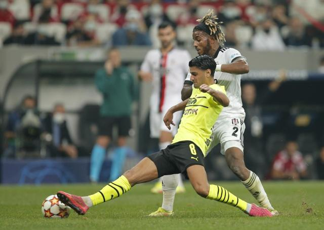 Dortmund's Mahmoud Dahoud, left, challenges for the ball with Besiktas' Valentin Rosier during the Champions League Group C soccer match between Besiktas and Borussia Dortmund at the Vodafone Park Stadium in Istanbul, Turkey, Wednesday, Sept. 15, 2021. (AP Photo)
