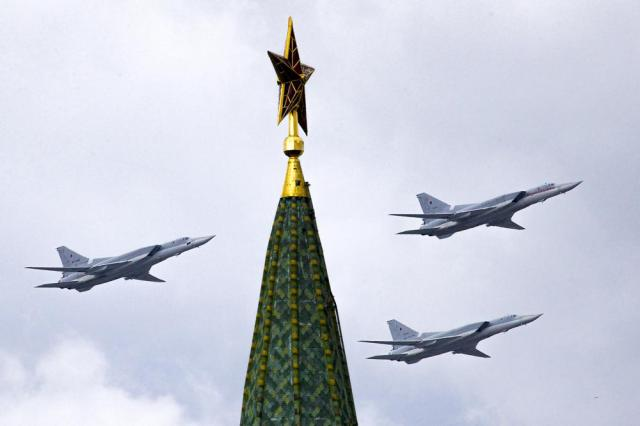 FILE - In this Thursday, May 5, 2016 file photo, Russian Tu-22M3 bombers fly over the Kremlin's Tower with a Red Star on the top during a general rehearsal for the Victory Day military parade which will take place at Moscow's Red Square on May 9 to celebrate 71 years after the victory in WWII in Moscow, Russia. The Russian military said Tuesday May 25, 2021, it has deployed three nuclear-capable long-range Tu-22M3 bombers to its base in Syria, a move that would strengthen Moscow's military foothold in the Mediterranean. (AP Photo/Ivan Sekretarev, File)