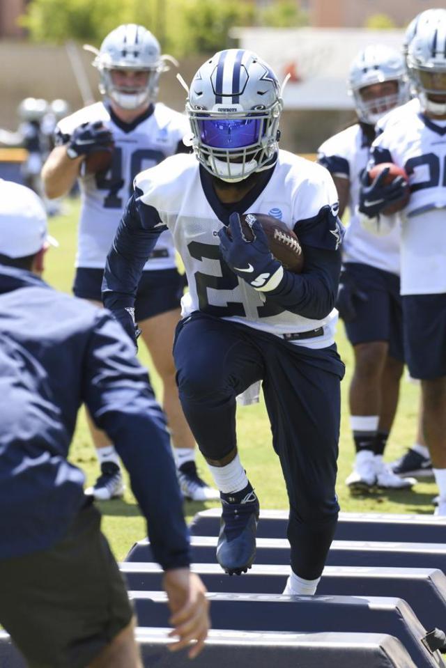 Dallas Cowboys running back Ezekiel Elliott runs a drill during practice at the NFL football team's training camp in Oxnard, Calif., Thursday, July 22, 2021. (AP Photo/Michael Owen Baker)