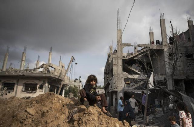 Palestinians inspect the damage of their destroyed homes after returning following a cease-fire reached after an 11-day war between Gaza's Hamas rulers and Israel, in town of Beit Hanoun, northern Gaza Strip, Friday, May 21, 2021. (AP Photo/Khalil Hamra)