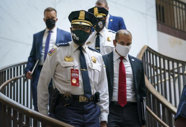 """Washington Metropolitan Police Chief Robert Contee arrives to joined U.S. Capitol Police Chief Tom Manger at a news conference to discuss preparations for a weekend rally planned by allies of Donald Trump who support the so-called """"political prisoners"""" of the Jan. 6 attack on the Capitol, Friday, Sept. 17, 2021, at the Capitol in Washington, (AP Photo/J. Scott Applewhite)"""