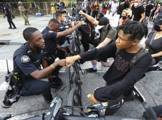 Black police officers torn between two worlds: obligation to my duty as a uniformed police officer; pain of seeing yet another black man killed at the hands of fellow officers