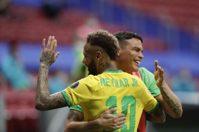 Brazil's Neymar, left, celebrates scoring his side's second goal against Venezuela on a penalty kick with teammate Thiago Silva during a Copa America soccer match at the National Stadium in Brasilia, Brazil, Sunday, June 13, 2021. (AP Photo/Eraldo Peres)
