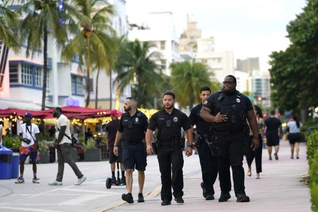City of Miami Beach code enforcement and police officers patrol along Ocean Drive, Friday, Sept. 24, 2021, in Miami Beach, Fla. For decades, this 10-block area has been one of the most glamorized spots in the world, made cool by TV shows like Miami Vice, where the sexiest models gathered at Gianni Versace's ocean front estate and rappers wrote lines about South Beach's iconic Ocean Drive. (AP Photo/Lynne Sladky)