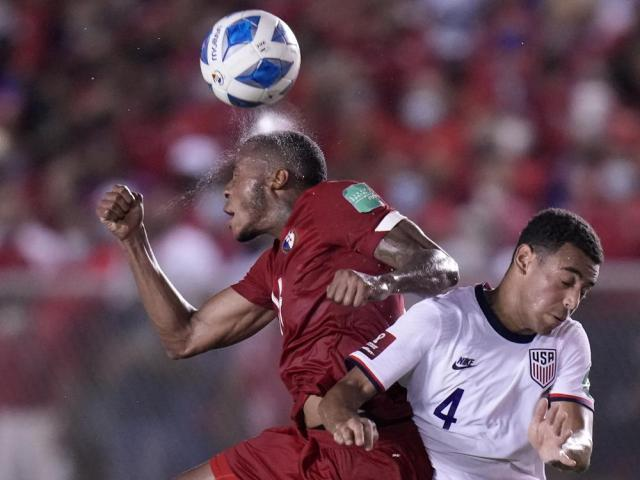 Panama's Alfredo Stephens, left, and United State's Tyler Adams head for the ball during a qualifying soccer match for the FIFA World Cup Qatar 2022 at Rommel Fernandez stadium, Panama city, Panama, Sunday, Oct. 10, 2021. (AP Photo/Arnulfo Franco)