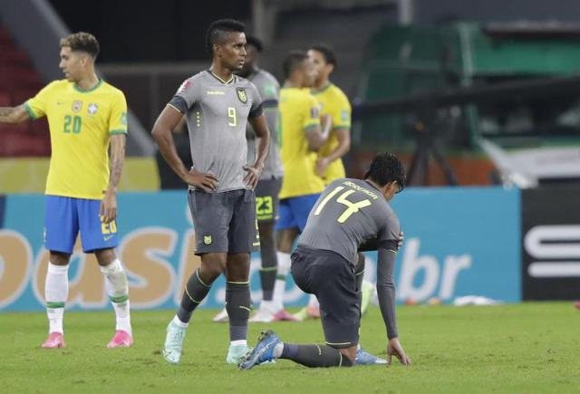 Ecuador's soccer players react after losing 2-0 against Brazil at the end of a qualifying soccer match for the FIFA World Cup Qatar 2022 at Beira-Rio stadium in Porto Alegre, Brazil, Friday, June 4, 2021. (AP Photo/Andre Penner)