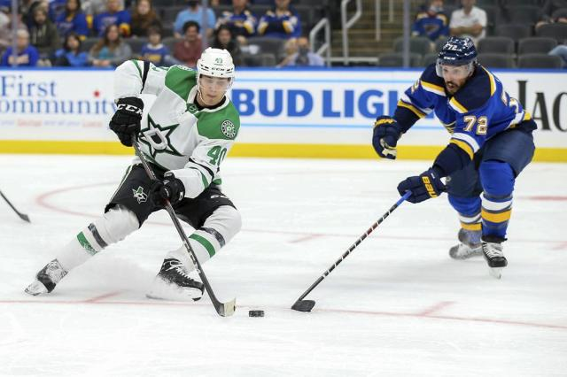 Dallas Stars' Miro Heiskanen (4) and St. Louis Blues' Justin Faulk (72) vie for control of the puck during the third period of a preseason NHL hockey game Monday, Sept. 27, 2021, in St. Louis. (AP Photo/Scott Kane)