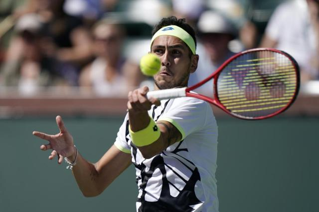 Alejandro Tabilo, of Chile, returns a shot to Matteo Berrettini, of Italy, at the BNP Paribas Open tennis tournament Sunday, Oct. 10, 2021, in Indian Wells, Calif. (AP Photo/Mark J. Terrill)