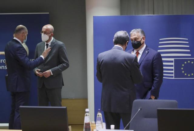Hungary's Prime Minister Viktor Orban, right, speaks with Cypriot President Nicos Anastasiades, second right, during a round table meeting at an EU summit in Brussels, Monday, May 24, 2021. European Union leaders are expected, during a two day in-person meeting, to focus on foreign relations, including Russia and the UK. (Yves Herman, Pool via AP)