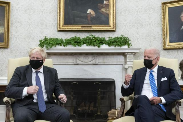 President Joe Biden, right, speaks during a meeting with British Prime Minister Boris Johnson in the Oval Office of the White House, Tuesday, Sept. 21, 2021, in Washington. (AP Photo/Alex Brandon)