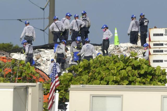 Rescue crews work at the site of the collapsed Champlain Towers South condo building after the remaining structure was demolished Sunday, in Surfside, Fla., Monday, July 5, 2021. Many people are unaccounted for in the rubble of the building which partially collapsed June 24. (AP Photo/Lynne Sladky)
