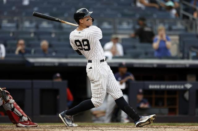 New York Yankees' Aaron Judge hits a three-run home run against the Minnesota Twins during the eighth inning of a baseball game on Monday, Sept. 13, 2021, in New York. (AP Photo/Adam Hunger)