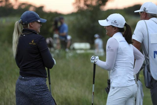 Matilda Castren, left, and Jin Young Ko wait to tee off on 18 during the third round of the LPGA Volunteers of America Classic golf tournament in The Colony, Texas, Saturday, July 3, 2021. (AP Photo/Richard W. Rodriguez)