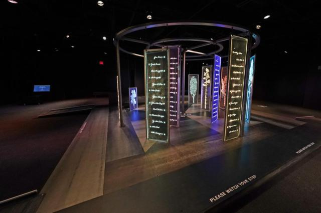 """The PBS Frontline's traveling augmented-reality exhibit, """"Un(re)solved"""", rests in the special exhibit room of the Two Mississippi Museums in Jackson, Friday, Aug. 27, 2021. The exhibit opened on Saturday, Aug. 28, to align with the commemoration of the death of Emmett Till, a Chicago teenager who was lynched in Mississippi in 1955. The multi-media platform examines the federal government's efforts to investigate more than 150 civil rights era cold cases on the Emmett Till Unsolved Civil Rights Crime Act. (AP Photo/Rogelio V. Solis)"""