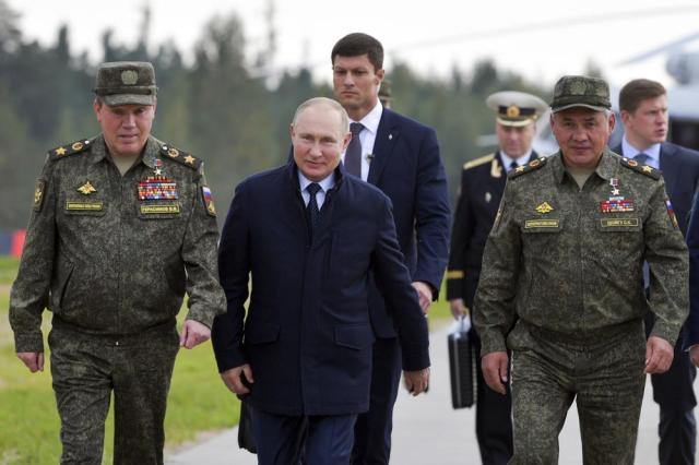 Russian President Vladimir Putin, center, Russian Defense Minister Sergei Shoigu, right, and Russian General Staff Valery Gerasimov, left, walk to attend the joint strategic exercise of the armed forces of the Russian Federation and the Republic of Belarus Zapad-2021 at the Mulino training ground in the Nizhny Novgorod region, Russia, Monday, Sept. 13, 2021. The military drills attend by servicemen of military units and divisions of the Western Military District, representatives of the leadership headquarters and personnel of military contingents of the armed forces of Armenia, Belarus, India, Kazakhstan, Kyrgyzstan and Mongolia. (Sergei Savostyanov, Sputnik, Kremlin Pool Photo via AP)