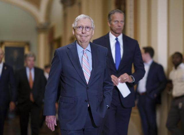 Senate Minority Leader Mitch McConnell, R-Ky., joined at right by Minority Whip John Thune, R-S.D., arrives to speak to reporters at the Capitol in Washington, Tuesday, July 13, 2021, following a weekly GOP strategy meeting. (AP Photo/J. Scott Applewhite)