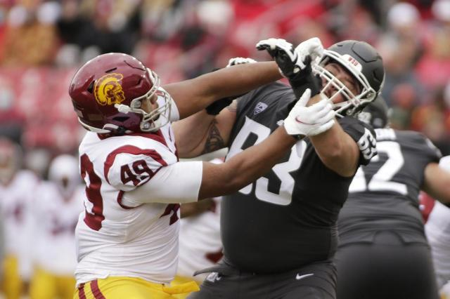 Washington State offensive lineman Liam Ryan (63) blocks Southern California defensive lineman Tuli Tuipulotu (49) during the second half of an NCAA college football game, Saturday, Sept. 18, 2021, in Pullman, Wash. Southern California won 45-14. (AP Photo/Young Kwak)