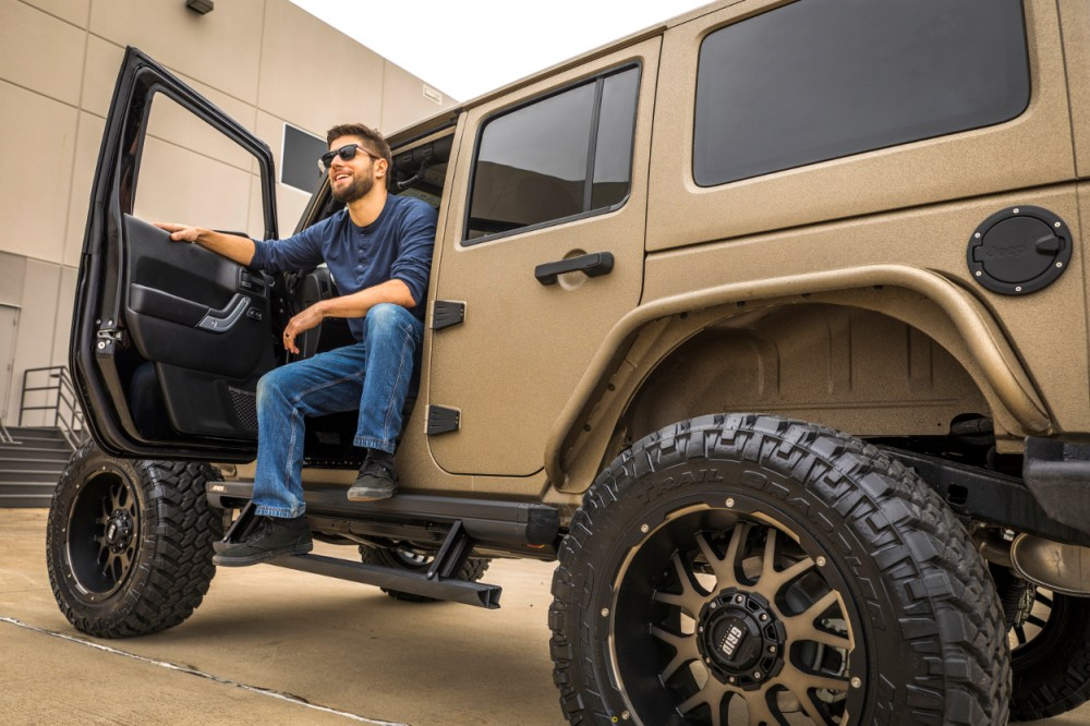 medium resolution of tan jeep wrangler jk with actiontrac power running boards
