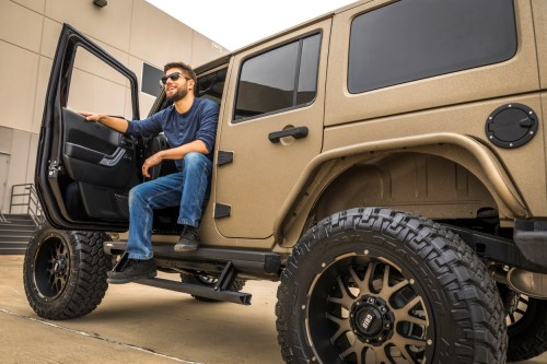 small resolution of tan jeep wrangler jk with actiontrac power running boards