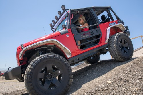 small resolution of red offroad jeep wrangler jk two door with aluminum tube doors